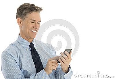 Businessman Text Messaging Through Mobile Phone