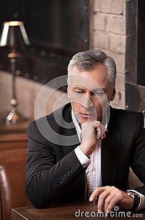 Businessman thinking about options. Thoughtful mature businessma