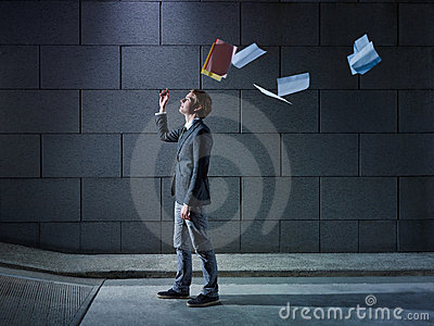 Businessman throwing away files and documents