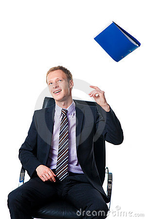 Businessman throwing away folder with documents