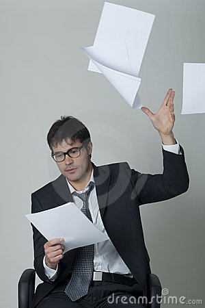 Businessman throwing documents away!