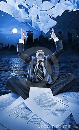 Businessman throwing papers at night