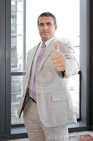 Businessman with thumbs up in outdoor