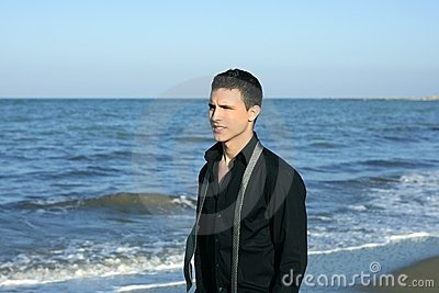 Businessman tie break on the blue beach