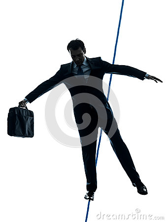 Businessman  tightrope walker silhouette