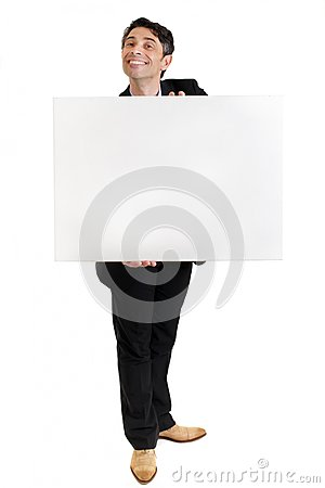 Businessman with a toothy grin with a blank sign