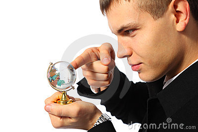 Businessman touches finger glass globe