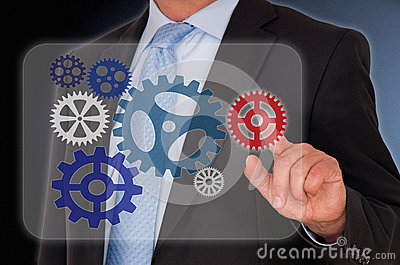 Businessman touching cogs