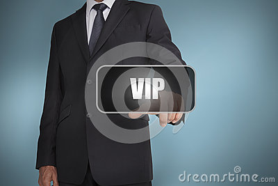 Businessman touching the word vip
