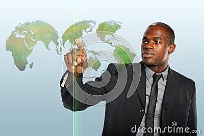 Businessman Touching World Hologram