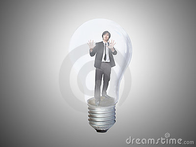 Businessman trapped in lightbulb