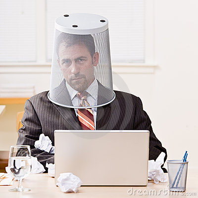 Businessman with trash basket on head