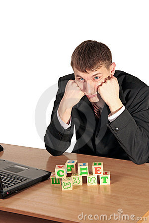 Businessman try compose blocks with a letters