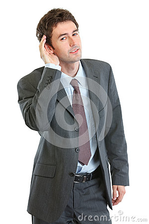 Businessman trying to hear valuable information