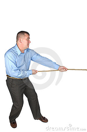 Businessman tug of war