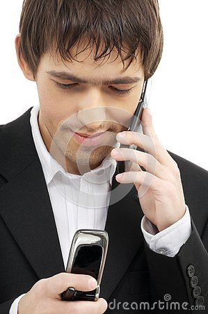 Businessman with two cellular phones