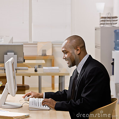 Businessman typing on computer at desk