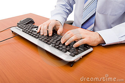 Businessman typing in the computer keyboard
