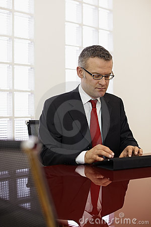Businessman typing on touch pad computer