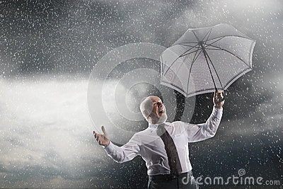 Businessman With Umbrella Laughing In Storm