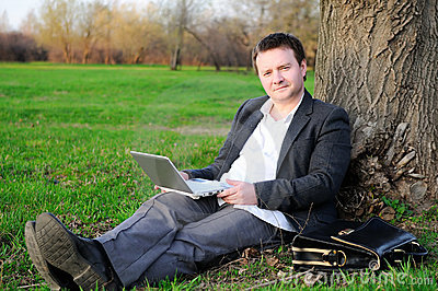 Businessman under a tree