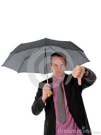 Businessman under umbrella giving a thumbs down
