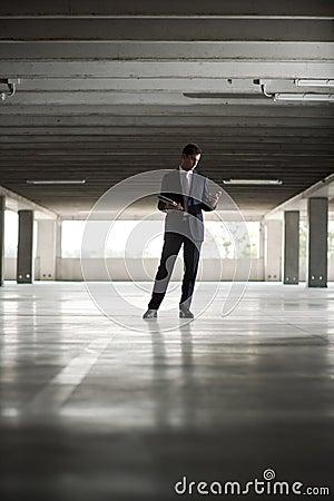 Businessman in underground parking