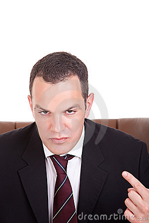 Businessman Upset Seated On A Chair Stock Images - Image: 14221074