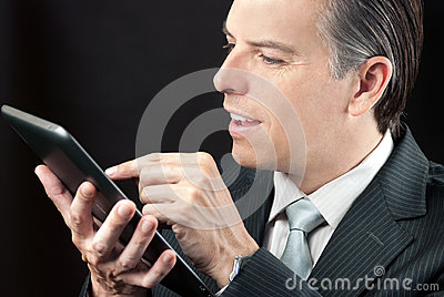 Businessman Uses Tablet, Close