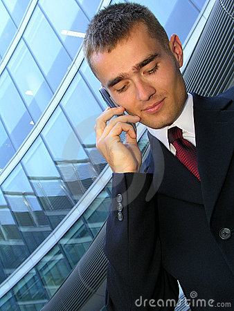 Free Businessman Using A Mobile Phone Royalty Free Stock Images - 212809