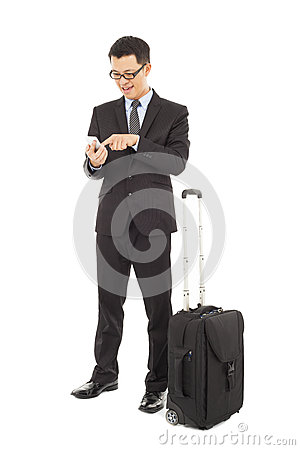 Businessman using a cell phone  with briefcase