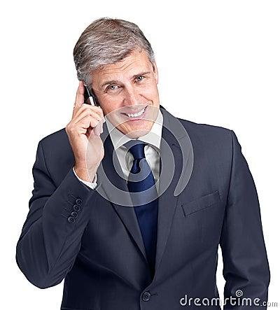 Businessman using a cellphone against white
