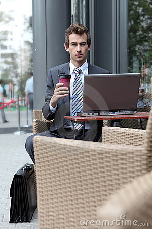 Businessman using his laptop in cafe