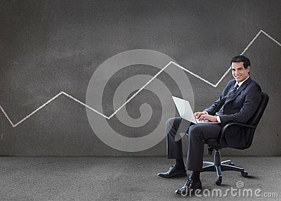 Businessman using his laptop with line on the wall