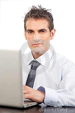 Businessman Using Laptop At Work