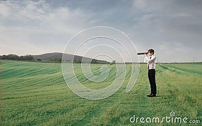 Businessman using a telscope