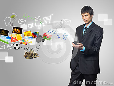 Businessman using touch screen mobile phone