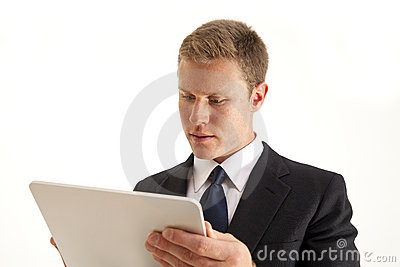 Businessman using touch screen tablet computer