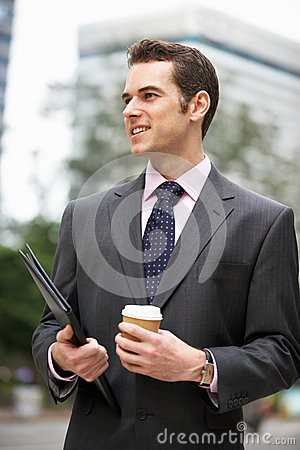 Businessman Walking Along Street
