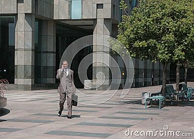 Businessman Walking Through Courtyard