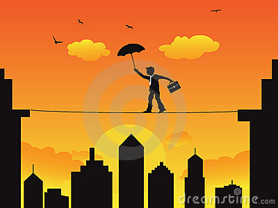 Businessman walking a high wire tightrope