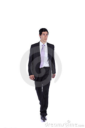 Businessman walking and looking away