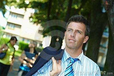Businessman walking in park