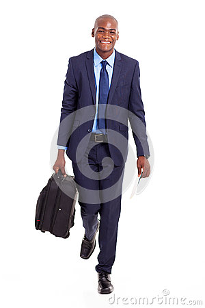 Businessman walking suitcase
