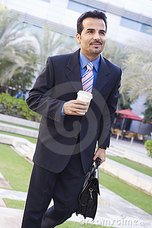 Businessman walking to work with coffee