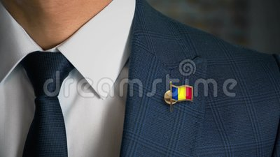 Businessman Walking Towards Camera With Country Flag Pin-Romania. In focus stock video