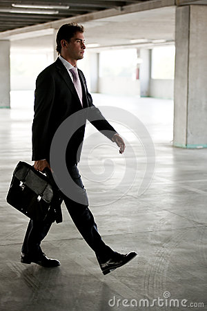 Businessman walking in underground parking