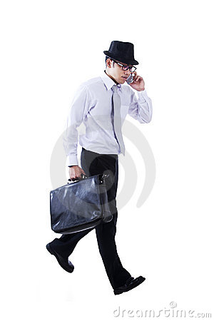 Businessman walks while calling