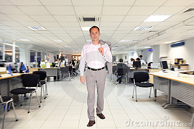Businessman walks in office
