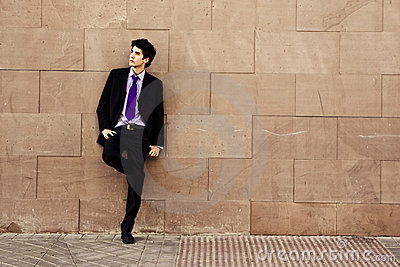 Businessman on wall